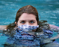 Young girl swimming with a mask on, Columbia south carolina photo by Catherine Brown