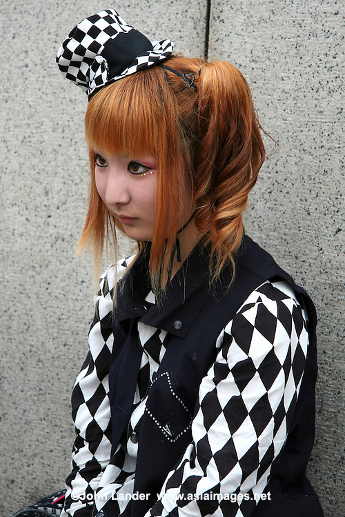 """Costume Play Checkerboard - A wide variety of """"costume play"""" creations are to be seen every Sunday in Harajuku, Tokyo's fashion quarter.  The freakier the costume, the more hits they get."""