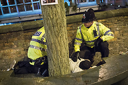 © Licensed to London News Pictures . FILE PICTURE DATED 05/05/2013 of police tending to a man lying on the ground in Central Manchester overnight , as the British Home Secretary , Theresa May , takes questions at the annual Police Federation conference on licensing and policing the night time economy , today (Wednesday 15th May 2013) . Photo credit : Joel Goodman/LNP