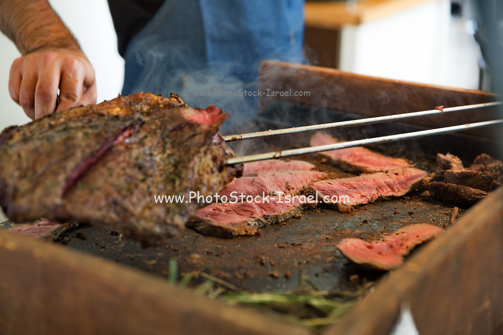 Preparing and serving Roast Beef at a buffet table