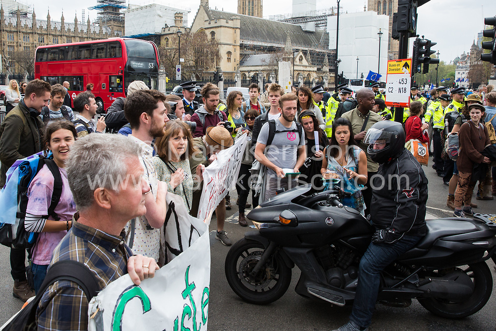 London, UK. 24th April 2019. Climate change activists from Extinction Rebellion block roads around Parliament Square on the tenth day of the International Rebellion to call on the British government to take urgent action to counter climate change.