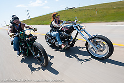 Lora and Tony Baccari on the Cycle Source motorcycle rodeo games during the 78th annual Sturgis Motorcycle Rally. Sturgis, SD. USA. Wednesday August 8, 2018. Photography ©2018 Michael Lichter.