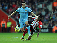 Samir Nasri of Manchester City is challenged by Nathaniel Clyne of Southampton<br /> - Barclays Premier League - Southampton vs Manchester City - St Mary's Stadium - Southampton - England - 30th November 2014 - Pic Robin Parker/Sportimage