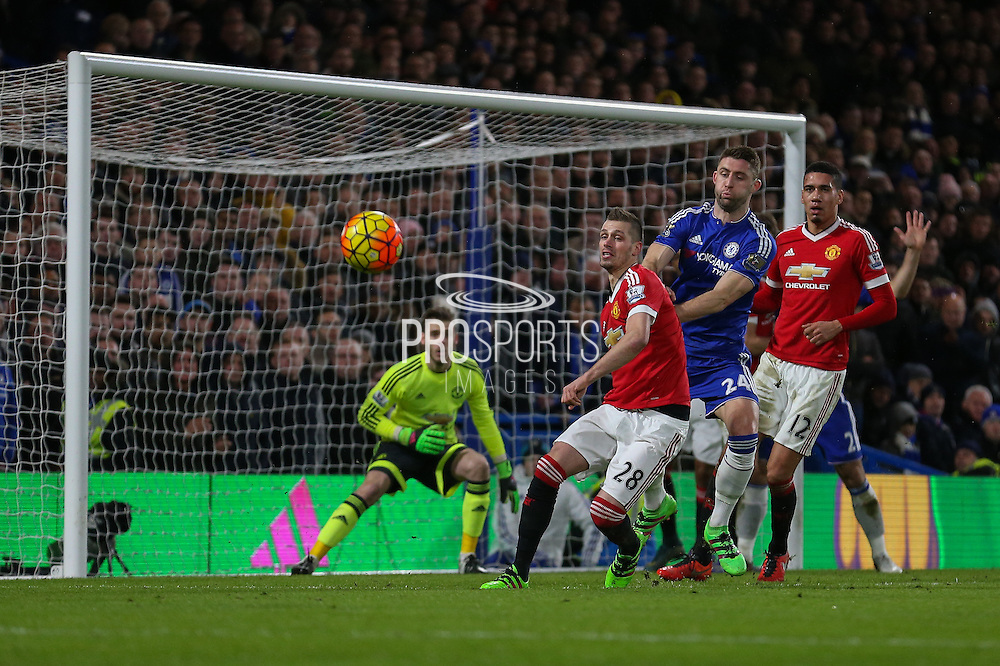 Morgan Schneiderlin of Manchester United attempts to clear during the Barclays Premier League match between Chelsea and Manchester United at Stamford Bridge, London, England on 7 February 2016. Photo by Ellie Hoad.