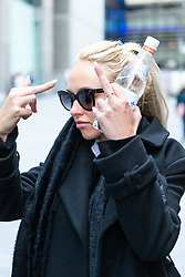 Stephanie Scolaro, 26, gestures obscenely as she leaves Southwark Crown Court In London where she is facing charges of smuggling python skin products into the UK. London, December 14 2018.