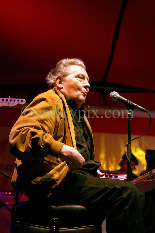 Dec 03 2007. New Orleans, Louisiana. Lower 9th Ward.<br /> Musical legend Jerry Lee Lewis plays at the 'Make it Right' event where Brad Pitt revisits the Lower 9th ward, devastated by Hurricane Katrina to present 'Make it Right' where architects' designs are unveiled to the public. <br /> Photo credit; Charlie Varley.