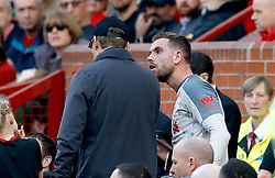 Liverpool's Jordan Henderson (right) has words with Liverpool manager Jurgen Klopp after he's substituted for Xherdan Shaqiri (not in frame) during the Premier League match at Old Trafford, Manchester.