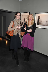 Left to right, POLLY IRWIN and TESS CAVENDISH at a private view of photographs by Christopher Thomas entit;ed 'Venice in Solitude' held at Hamiltons, 13 Carlos Place, London on 31st January 2012.