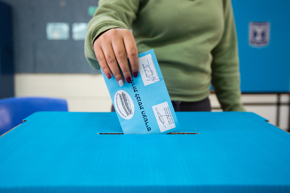 An Israeli woman casts her vote at a polling station in Jerusalem, Israel, on March 17, 2015, as Israelis vote in early parliament elections.