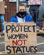 """Women holding a sign """"Protect women not statues"""" sitting at the entrance to Alex Chalk's offices, Cheltenham's MP. 20/03/2021"""