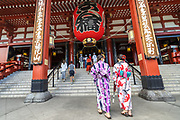 Japanese women dressed in kimono enter the main hall of the Sensoji Buddhist temple in Asakusa, Tokyo, Japan. The temple was built during the Kamakura period in 645 CE and is the oldest and most important temple in Tokyo.
