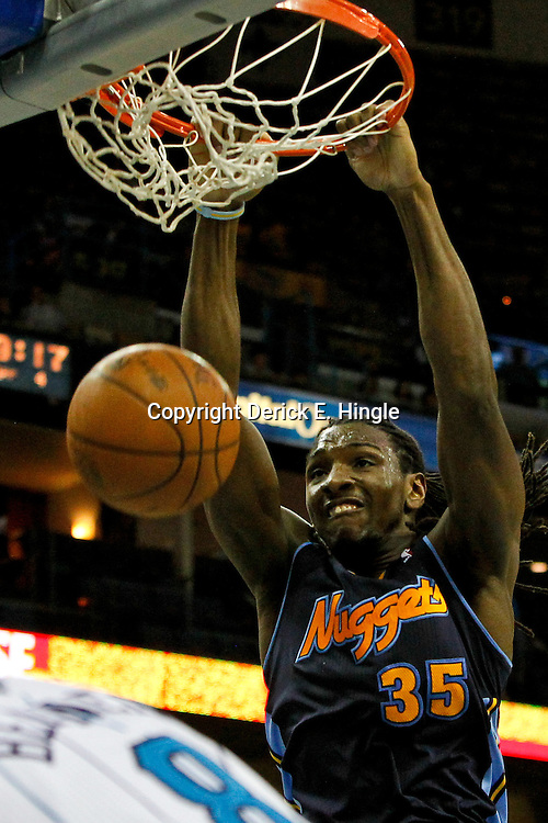 April 4, 2012; New Orleans, LA, USA; Denver Nuggets forward Kenneth Faried (35) dunks against the New Orleans Hornets during the second half of a game at the New Orleans Arena. The Hornets defeated the Nuggets 94-92.  Mandatory Credit: Derick E. Hingle-US PRESSWIRE