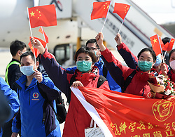 March 18, 2020, Hefei, China: Medics supporting virus-hit Hubei Province wave to greeters upon their arrival in Hefei Xinqiao International Airport in Hefei, east China's Anhui Province. Medical assistance teams started leaving Hubei Province as the epidemic outbreak in the hard-hit province has been subdued. (Credit Image: © Zhou Mu/Xinhua via ZUMA Wire)
