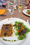 A tarte fine d oignon - think onion tart with salad and a glass of water and white chateauneuf. The restaurant Le Verger de Papes in Chateauneuf-du-Pape Vaucluse, Provence, France, Europe