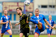 Carlisle United Rod McDonald (5) Scunthorpe United Aaron Jarvis (19) battles for possession during the EFL Sky Bet League 2 match between Carlisle United and Scunthorpe United at Brunton Park, Carlisle, England on 18 September 2021.