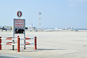 Israel, Ben-Gurion international Airport Beware Crossing Aircraft sign in Hebrew and English