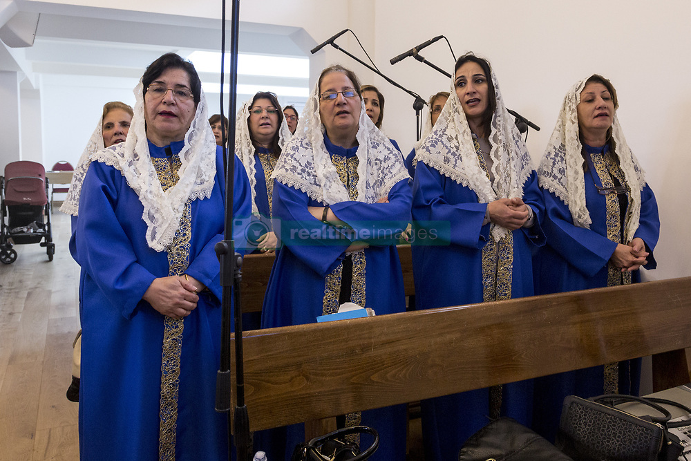 August 20, 2017 - London, England, United Kingdom - Iraqi Christians hold the Holy Mass in the St. Thomas Cathedral in London on the 20th of August, 2017. They belong to the Syriac Orthodox Church, one of the most ancient Christian communities. Most of the worshipers are refugees from Mosul and its neighbourhoods. (Credit Image: © Dominika Zarzycka/NurPhoto via ZUMA Press)