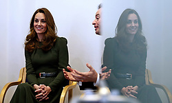 The Duchess of Cambridge sits with Family Action CEO David Holmes (right) as she speaks with people supported by the charity during a visit to Family Action charity's Lewisham base in Forest Hill, Lewisham, London.