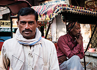NEW DELHI, INDIA - CIRCA NOVEMBER 2018: Cycle rickshaw driver in the streets around the spice market and the Chandni Chowk area in Old Delhi.