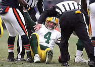 Green Bay Packers' Brett Favre is helped up by Chicago Bears' Jamar Williams after fumbling a snap in the 4th quarter. .The Green Bay Packers traveled to Soldiers Field in Chicago to play the Bears Sunday December 23, 2007. Steve Apps-State Journal.