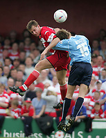 Photo. Andrew Unwin<br /> Doncaster Rovers v York, Nationwide League Division Three, Earth Stadium, Belle Vue, Doncaster 24/04/2004.<br /> Doncaster's Chris Brown (l) beats York's Leigh Wood (r) in the air.
