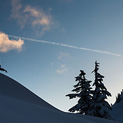A jet contrail mimics a freeskiing straight line set of tracks in the Cascades.