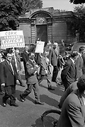 03/07/1963<br /> 07/03/1963<br /> 03 July 1963<br /> RGDATA Turnover Tax Protest March in Dublin. Picture shows the businessmen's protest, a Co. Cork Grocer carries his banner on a neatly folded umbrella.