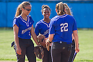 Middletown, New York - Middletown High School players meet before the start on an inning during a varsity girls' softball game on April 25, 2014.