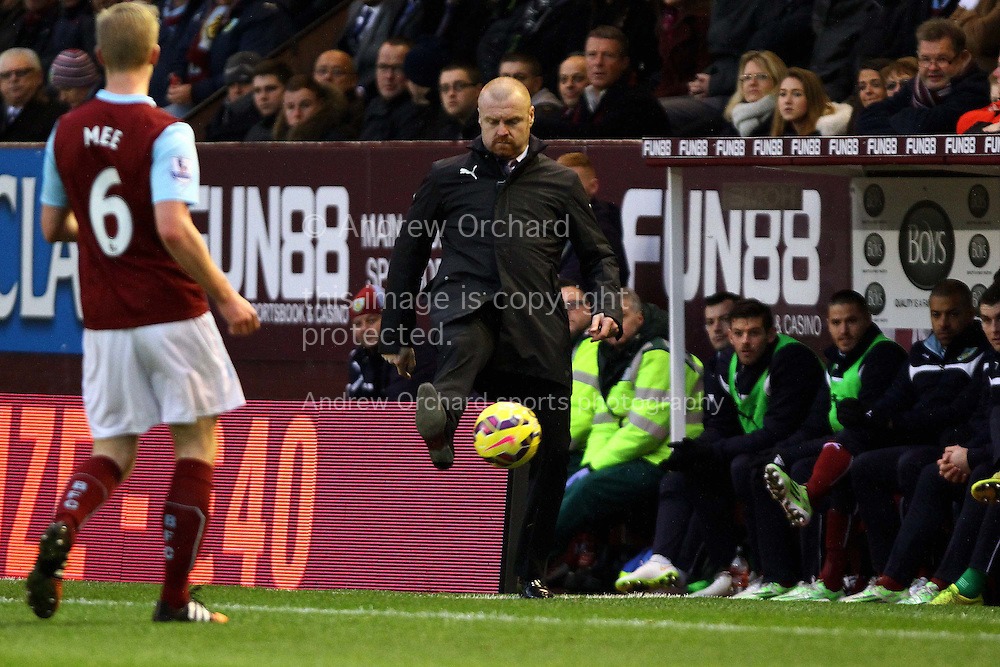 Burnley Manager Sean Dyche looks to control the ball. Barclays Premier league match, Burnley v Liverpool at Turf Moor in Burnley, Lancs on Boxing Day, Friday 26th December 2014.<br /> pic by Chris Stading, Andrew Orchard sports photography.