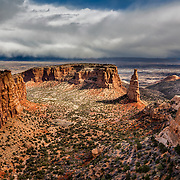 A storm rolls in over the Grand Valley towards Colorado National Monument as seen from Independence Monument overlook.