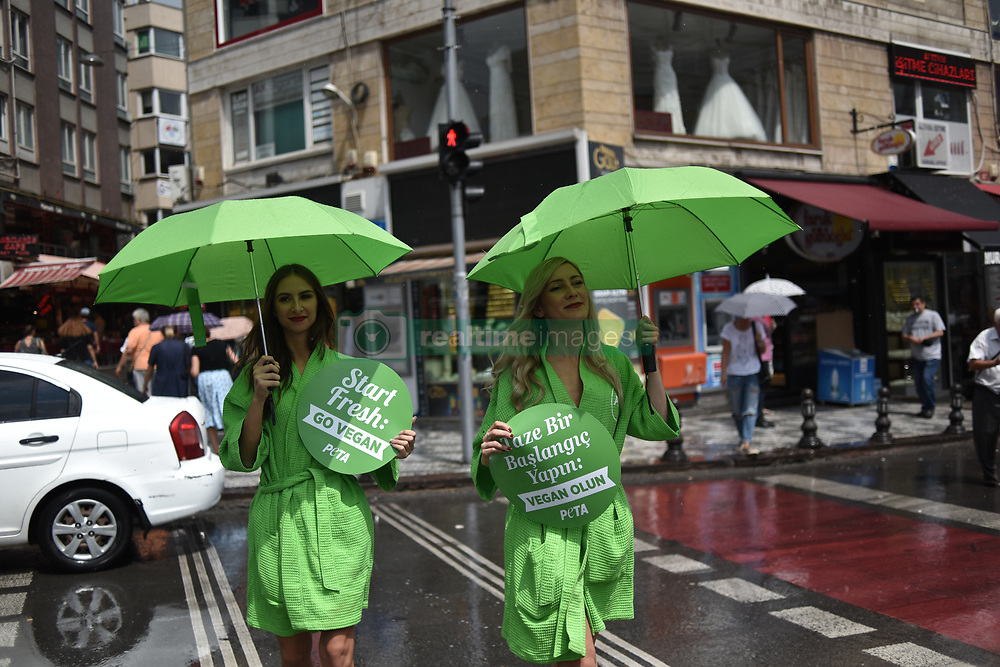 August 17, 2017 - °Stanbul, Türkiye - A group of PETA  (People for the Ethical Treatment of Animals) activists, stands during an event promoting a vegan lifestyle, Kadikoy, Istanbul. (Credit Image: © Depo Photos via ZUMA Wire)