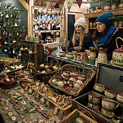 BUDAPEST, HUNGARY - DECEMBER 07:   A woman buys some traditional Hungarian pottery at the  Vorosmarty Square Christmas market on December 7, 2017 in Budapest, Hungary. The traditional Christmas market and lights will stay until 31st December 2017.