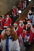 Moscow, Russia, 17/12/2005.&#xA;Putin supporters dressed as Santa Claus walk in the Moscow metro system after a demonstration. &#xA;Approximately 70,000 members of the pro Kremlin youth organisation Nashi [Ours],  demonstrated to wish World War Two veterans a happy New Year. Most of the demonstrators were dress as Dyed Moroz, the Russian Santa Claus, or his partner Snegurichka, the Snow Maiden.<br />