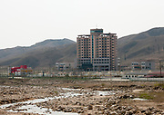 KUMGANG<br /> THE NORTH KOREAN GHOST TOWN<br /> <br /> The first town USA will find on his way to invade NK will be this ghost town where HUnday lost 1 billion USD..<br /> <br /> The Mount Kumgang tourist complex in North Korea, near the DMZ, was built in 1998 by the South Korean giant company Hyundai. The chaebol paid a fee of $1 billion to the North Korean government for 50 years of exclusivity. The cost of the 500-square kilometer complex was $400 million, including hotels, a spa, a fire station, a tourism office, a golf course, a supermarket, a clinic, tours in the mountain... Kumgang resort attracted nearly 2 millions south korean tourists from1998 to 2008.<br /> In July 2008 a South Korean tourist, Miss Park Wang-ja, was shot dead there and South Korea decided to stop all the tours in North Korea. The North Korean government said the tourist entered the military zone, and ignored the warnings from the north korean soldiers.<br /> So in retaliation, North Korea decided to seize the whole tourist complex. This decision was a real drama. Not for the touristic industry only, but for the separated families from the south and the north: Kumgang was also the place where hundreds of North and South Korean relatives were meeting each other for the first time in decades.<br /> For those reasons, since 2008, Mount Kumgang complex has became a ghost town. Only very few western tourists could visit the area.<br /> <br /> Photo shows:    Hyundai paid a fee of $1 billion to the North Korean government for 50 years of exclusivity. The cost of the 500-square kilometer complex was $400 million, including hotels, a spa, a tourism office, a golf course, a supermarket, a clinic, tours in the mountain...<br /> ©Eric Lafforgue/Exclusivepix Media