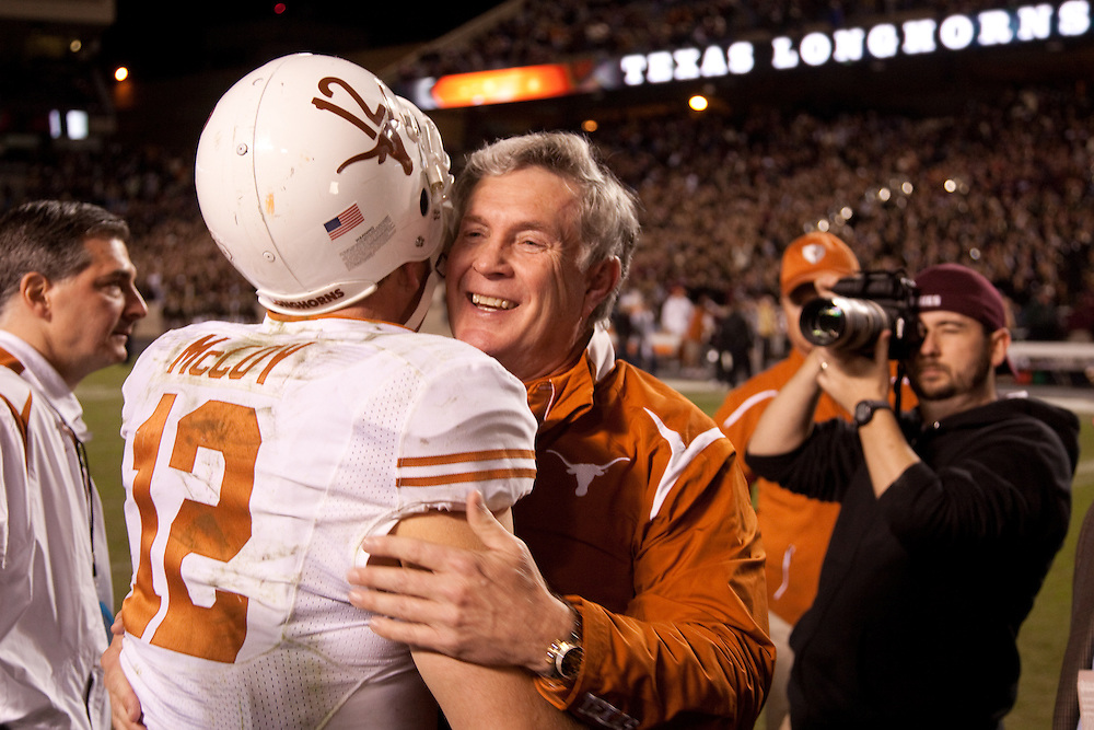 Mack Brown, head coach, hugs Colt McCoy, quarterback #12. Texas Longhorns at Texas A&M Aggies. Photographed at Kyle Field in College Station, Texas on Thursday, November 26 2009. Photograph © 2009 Darren Carroll