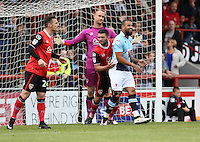 Blackpool's Kyle Vassell under close scrutiny from Morecambe's goalkeeper Barry Roche and Alex Kenyon<br /> <br /> Photographer Stephen White/CameraSport<br /> <br /> Football - The EFL Sky Bet League Two - Morecambe v Blackpool - Saturday 13th August 2016 - Globe arena - Morecambe<br /> <br /> World Copyright © 2016 CameraSport. All rights reserved. 43 Linden Ave. Countesthorpe. Leicester. England. LE8 5PG - Tel: +44 (0) 116 277 4147 - admin@camerasport.com - www.camerasport.com