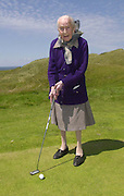 103 YEARS OLD KERRY LADY PLAY GOLF ON HER BIRTHDAY.....Ballybunion in Co. Kerry may be the majestic setting for the Murphy's Irish Open this week but on Monday local lady Peg Mahony celebrated her 103rd birthday with a visit to the championship links. Born accross the road for the famous course, now rated 6th best in the world, Peg decided to spend a short time down on the course  where the professionals have started practising for Thursday's tee-up. Local groundsman Paul Murphy ferried Peg around the 18th gren in a buggy and then Peg took a few swings before holing a wonderful 10ft putt on the practise green.  Later in the day Peg enjoyed a wonderful party with her three sisters, (all over 90years of age) at the family home in Doon Road, Ballybunion..Picture by Don MacMonagle.Full sotry by Anne Lucey