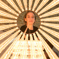 London, UK - 15 September 2014: A member of the staff looks at 'Column (Assemblages) V, 2010' by Cerith Wyn Evans during the press preview of his new solo exhibition at Serpentine Sackler Gallery.