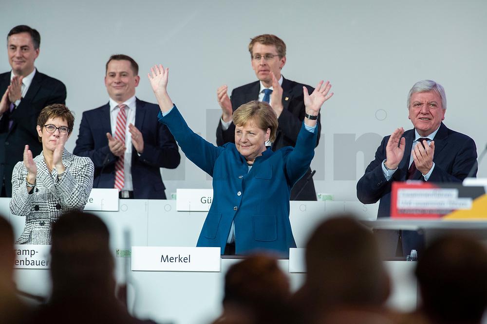 07 DEC 2018, HAMBURG/GERMANY:<br /> Angela Merkel, CDU, Bundeskanzlerin, nach Ihrer letzten Rede als Parteivorsitzende, unten links: Annegret Kramp-Karrenbauer, CDU Generalsekretaerin, unten rechts: Volker Bouvier, CDU, Ministerpraesident Hessen, hinten v.L.n.R.: David McAllister, CDU, MdEP, Dr. Roland Heintze, CDU Landesvorsitzender Hamburg, Daniel Guenther, CDU, Ministerpraesident Schleswig-Holstein, CDU Bundesparteitag, Messe Hamburg<br /> IMAGE: 20181207-01-083<br /> KEYWORDS: party congress, Appluas, applaudiren, klatschen, Jubel, Daniel Günther
