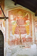 Religious mural of St Christopher with Christ on his shoulders by Dionislo Baschenis, dated 1493, on the exterior of the Gothic Church of San Antonio Abate,  Pelugo, Province of Trento, Italy .<br /> <br /> Visit our ITALY PHOTO COLLECTION for more   photos of Italy to download or buy as prints https://funkystock.photoshelter.com/gallery-collection/2b-Pictures-Images-of-Italy-Photos-of-Italian-Historic-Landmark-Sites/C0000qxA2zGFjd_k<br /> If you prefer to buy from our ALAMY PHOTO LIBRARY  Collection visit : https://www.alamy.com/portfolio/paul-williams-funkystock/san-antonio-abate-pelugo.html