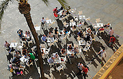 Looking form overhead down on people at restaurant tables in Plaza de la Catedral, Cadiz, Spain