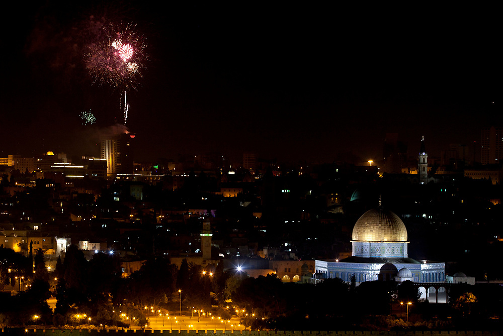 Fireworks explode over Jerusalem's Old City and over the golden Dome of the Rock Islamic shrine during the celebrations for Israel's Independence Day marking the 63rd anniversary of the creation of the state on May 9, 2011.