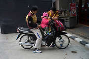 A couple protect their child from the cold, in Fang , Thailand. PHOTO TIAGO MIRANDA