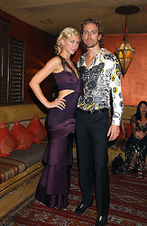 Actress MARGO STILLEY and CHRISTIAN HELLAND at a dinner hosted by Ayesha Makim and leading stylist Mohieb Dahabieh to celebrate the forthcoming London Fashion Week held at the exotic restaurant Levant, 76 Wigmore Street, London W1 on 8th September 2005.<br />