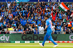 India fans celebrate Yuzvendra Chahal of India taking the wicket of Kane Williamson of New Zealand - Mandatory by-line: Robbie Stephenson/JMP - 09/07/2019 - CRICKET - Old Trafford - Manchester, England - India v New Zealand - ICC Cricket World Cup 2019 - Semi Final