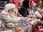 17 SEPTEMBER 2015 - BANGKOK, THAILAND:  Santa Clauses from around the world watch the Santa pageant in Bangkok. Twenty-six Santa Clauses from around the world are in Bangkok for the first World Santa Claus Congress. The World Santa Claus Congress has been an annual event in Denmark since 1957. This year's event, hosted by Snow Town, a theme park with a winter and snow theme, hosted the event. There were Santas from Japan, Hong Kong, the US, Canada, Germany, France and Denmark. They presented gifts to Thai children and judged a Santa pageant. Thailand, a Buddhist country, does not celebrate the religious aspects of Christmas, but Thais do celebrate the commercial aspects of the holiday.   PHOTO BY JACK KURTZ