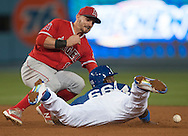 The Angels' Johnny Giavotella can't handle the throw as the Dodgers' Yasiel Puig steals second base during the Angels' Freeway Series game against the Dodgers Thursday night at Dodger Stadium.<br /> <br /> ///ADDITIONAL INFO:   <br /> <br /> freeway.0401.kjs  ---  Photo by KEVIN SULLIVAN / Orange County Register  --  3/31/16<br /> <br /> The Los Angeles Angels take on the Los Angeles Dodgers at Dodger Stadium during the Freeway Series Thursday.<br /> <br /> <br />  3/31/16
