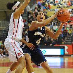 Notre Dame Fighting Irish guard Skylar Diggins (4) tries to get past Rutgers Scarlet Knights guard Nikki Speed (11) during first half NCAA Big East women's basketball action between Notre Dame and Rutgers at the Louis Brown Athletic Center. Notre Dame leads 40-23 at halftime.