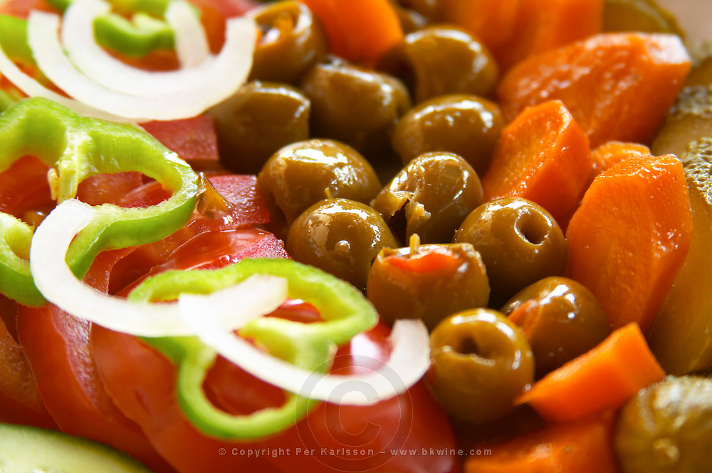 Salad with tomatoes, onions, green bell peppers, olives and carrots. Berat lower town. Albania, Balkan, Europe.