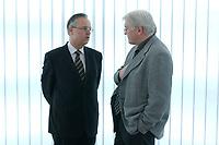 17 MAR 2003, BERLIN/GERMANY:<br /> Hans Eichel (L), SPD, Bundesfinanzminister, und Frank-Walter Steinmeier (R), SPD, Staatssekretaer u. Chef Bundeskanzleramt, im Gespraech, vor Beginn der Sitzung des SPD Praesidiums, Willy-Brandt-Haus<br /> IMAGE: 20030317-01-013<br /> KEYWORDS: Präsidium, Staatssekretär, Gespräch